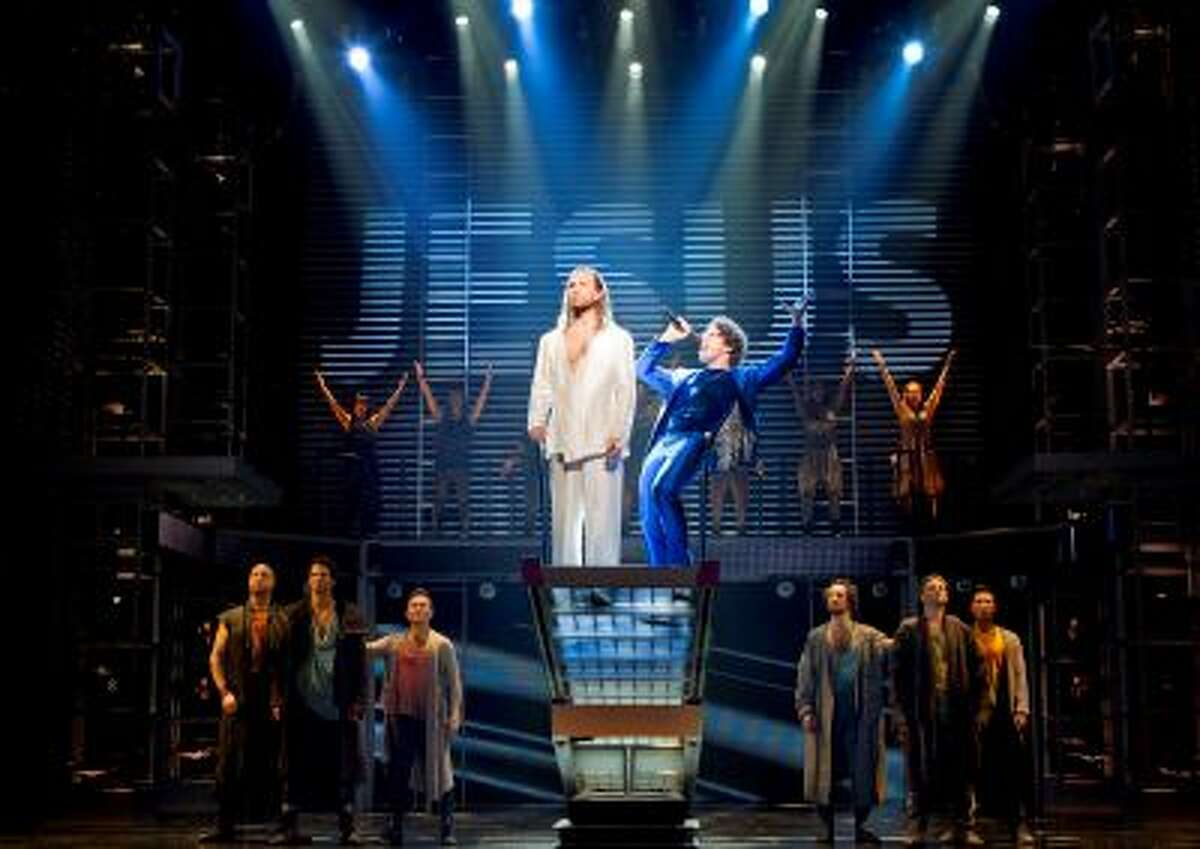 """In this theater publicity image released by Boneau/Bryan-Brown, Paul Nolan, center left, and Josh Nolan are shown with the cast during a performance of """"Jesus Christ Superstar,"""" in New York. (AP Photo/Boneau/Bryan-Brown, Joan Marcus)"""