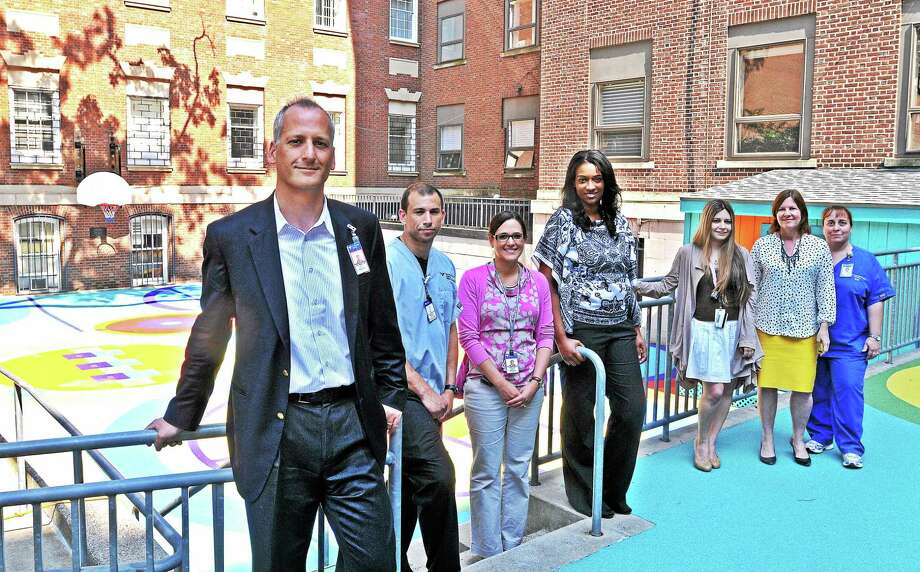 Dr. Andres Martin and his team at the Children's Psychiatric Inpatient Center are seen in the Terry's Dream playground. Photo: Peter Casolino — New Haven Register