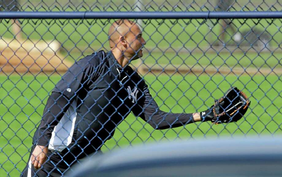 New York Yankees shortstop Derek Jeter plays catch during a workout Thursday at the team's minor league facility in Tampa, Fla. Jeter announced Wednesday he will be retiring at the end of the 2014 season. Photo: Chris O'Meara — The Associated Press   / AP