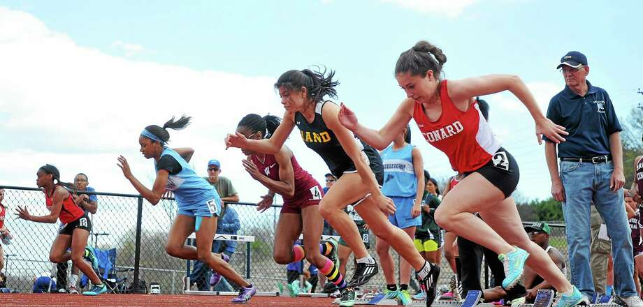 (Peter Casolino-New Haven Register)  Girls take off at a 100-meter dash heat at the Middletown Outdoor Track and Field Invite. 5/03/14 pcasolino@newhavenregister.com Photo: Journal Register Co.