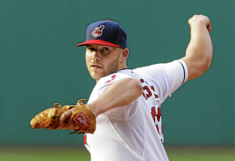 Indians starting pitcher Justin Masterson delivers in the first inning of Monday's game against the Boston Red Sox. Masterson pitched 7 innings and gave up three hits. The Indians defeated the Red Sox 3-2. Photo: Tony Dejak — The Associated Press   / AP