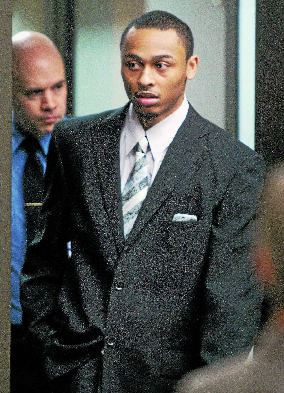 (Arnold Gold-New Haven Register) Cordaryl Silva enters the courtroom at Milford Superior Court on April 1.