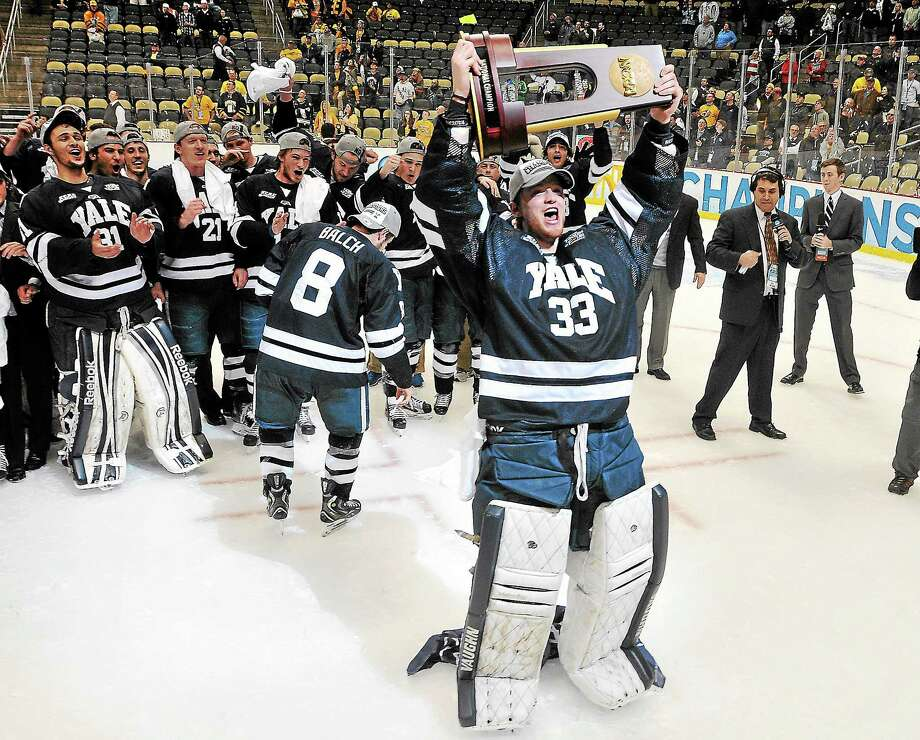 Yale celebrates its victory over Quinnipiac in the national championship game last April in Pittsburgh. The fourth-ranked Bobcats and 13th-ranked Bulldogs meet for the second time this season Friday night at Ingalls Rink. They tied 3-3 on Nov. 9 in Hamden. Photo: Peter Casolino — Register