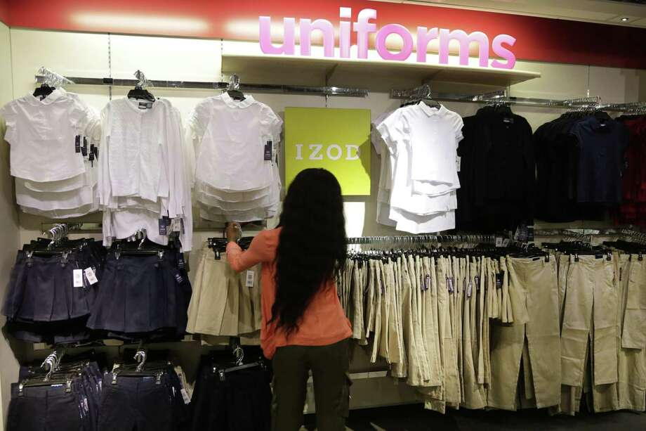 In this July 31, 2013, photo, school uniforms by Izod are displayed at JC Penney in New York.  Shoppers, worried about their finances, showed they were more interested in buying discounted summer merchandise in July than in picking up new fall clothing for their children, according to figures released Thursday, Aug. 8, 2013. (AP Photo/Mark Lennihan) Photo: AP / AP
