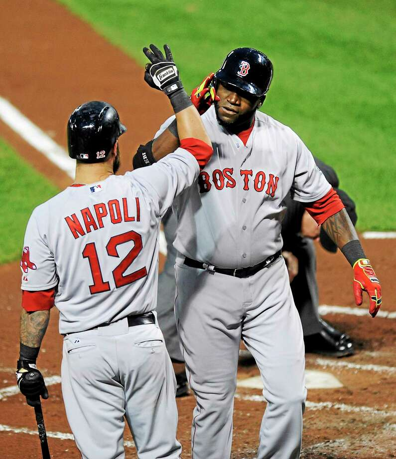 Boston Red Sox designated hitter David Ortiz, right, celebrates his two-run home run with Mike Napoli (12). Photo: Nick Wass — The Associated Press   / FR67404 AP