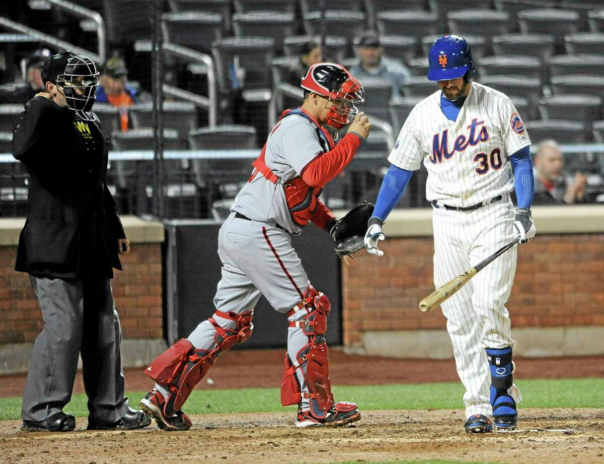 New York Mets right fielder Andrew Brown (30) strikes out for the final out.