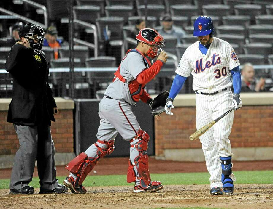 New York Mets right fielder Andrew Brown (30) strikes out for the final out. Photo: Kathy Kmonicek — The ASSOCIATED PRESS   / FR170189 AP