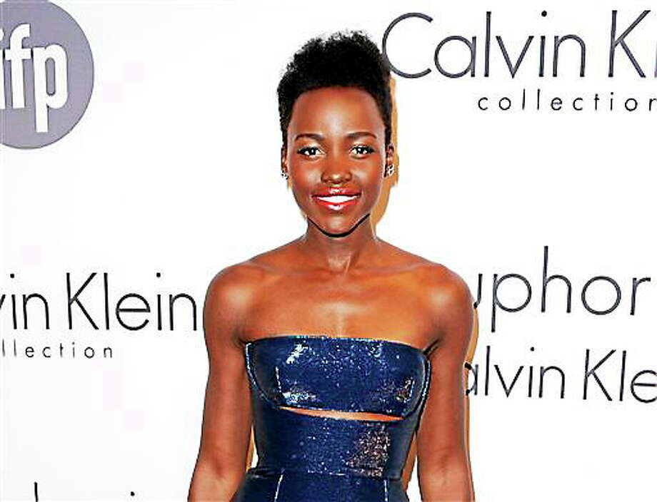 """Lupita Nyong'o at the IFP and Calvin Klein Women In Film Party at the 67th international film festival, Cannes, southern France. The Walt Disney Co. announced Monday that Nyong'o is joining the cast of """"Star Wars: Episode VII"""" The 31-year-old actress became a breakthrough star for her award-winning performance in """"12 Years a Slave."""" Photo: Associated Press   / Invision"""
