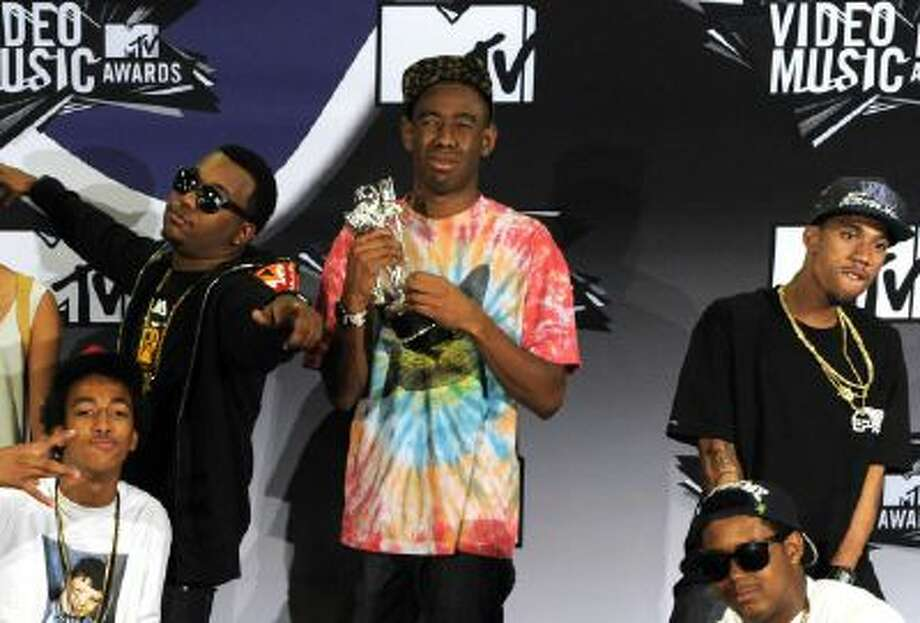 Tyler the Creator, holding the award for best new artist, and Odd Future, pose backstage at the MTV Video Music Awards on Sunday Aug. 28, 2011, in Los Angeles.