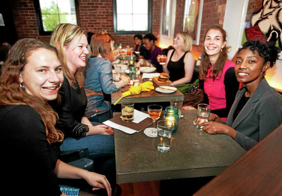 Front left to right: Pam Soulos, Jen Clessas, Irena Samsel. Pam Soulos and Sarah McQueen. They have founded a meet-up group for women born in the 1980s, which meets at 116 Crown St. in New Haven. Photo: Melanie Stengel — New Haven Register