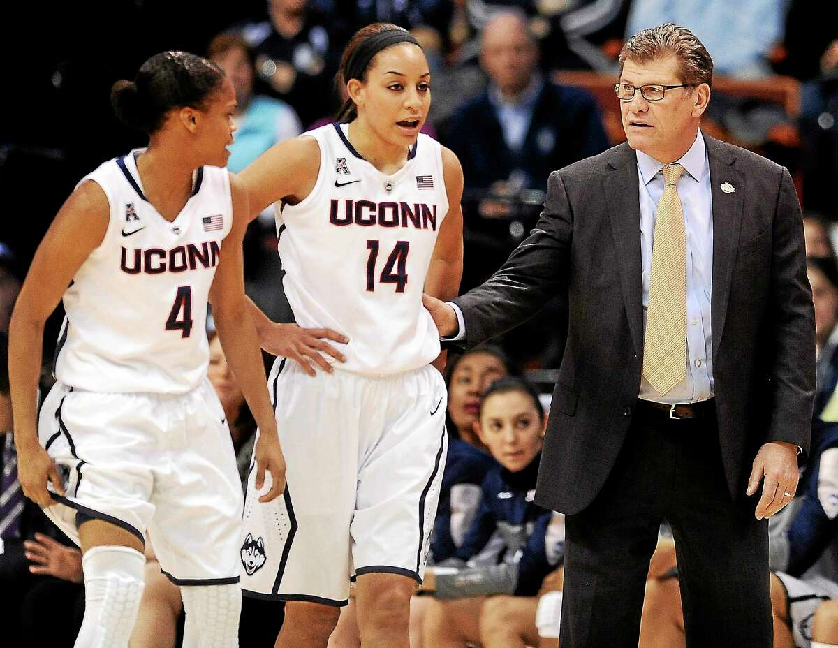 UConn head coach Geno Auriemma, right, speaks with Moriah Jefferson, left, and Bria Hartley during an AAC tournament game against Rutgers on March 9 in Uncasville.