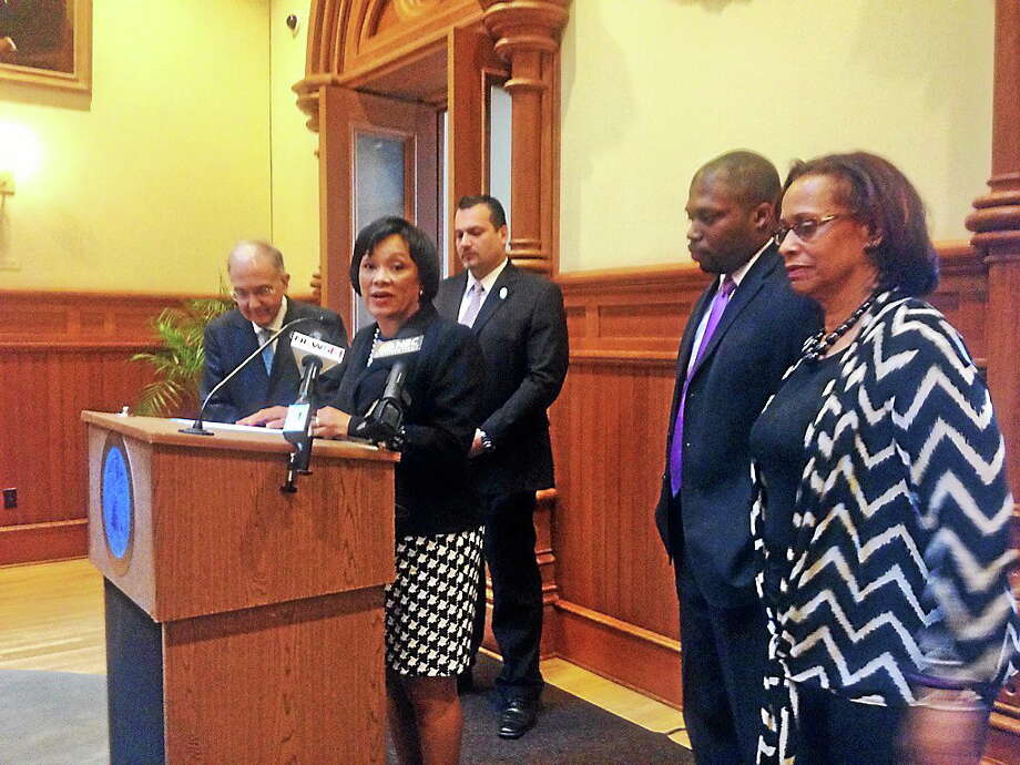 New Haven Mayor Toni N. Harp speaks at City Hall about state aid this year. At left is state Senate Majoriy Leader Martin Looney, in rear is state Rep. Juan Candelaria, and at right are  state Sen. Gary Holder-Winfield and Rep. Toni Walker. Photo: (Rachel Chinapen - New Haven Register)