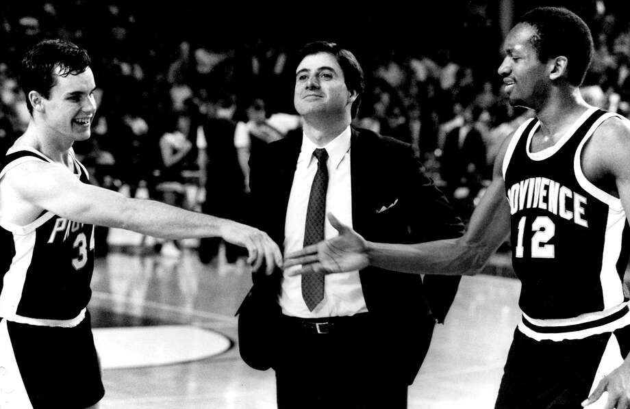 Providence coach Rick Pitino stands betweem Billy Donovan, left, and Delray Brooks as they congratulate each other after the Friars' 103-82 victory over Alabama in the NCAA tournament Southeast Regional in Louisville, Ky., on March 19, 1987. Donovan scored 26 points in the victory. Photo: Rob Kozloff — The Associated Press File Photo   / AP2007