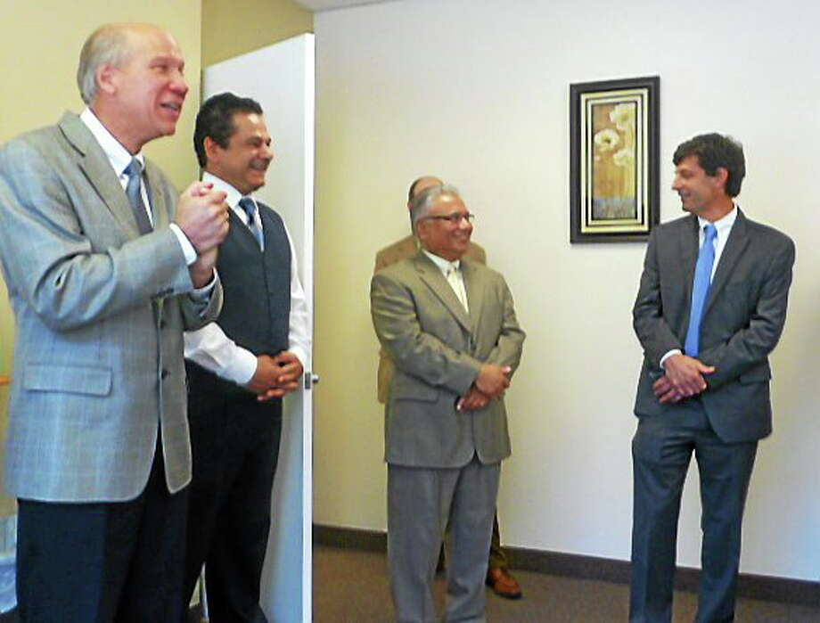 At Monday's opening of My Health 1st Urgent Care in Ansonia are, from left, Greater Valley Chamber of Commerce President William Purcell, Ansonia Mayor David S. Cassetti and co-owners Ali Shauket and Stephen Arndt. Patricia Villers/Register Photo: Journal Register Co.