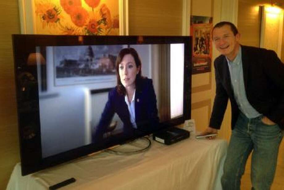 """Neil Hunt, Netflix's chief product officer, demonstrates ultra high definition streaming of a """"House of Cards"""" trailer."""