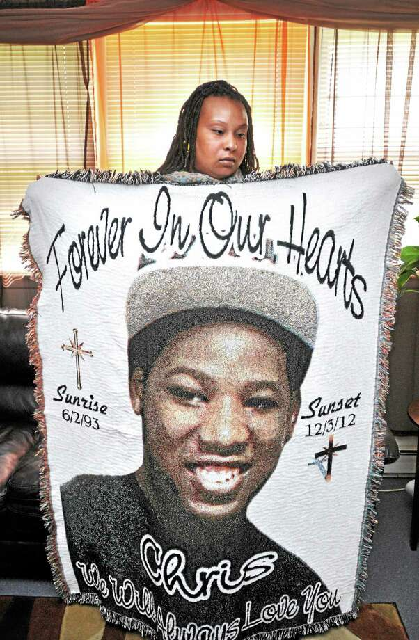 Lauren Pittman is photographed with a blanket memorializing her deceased brother, Christopher Fain, at her apartment in New Haven on May 29.  The blanket was given to her by her mother as a Christmas present. Photo: ARNOLD GOLD — NEW HAVEN REGISTER