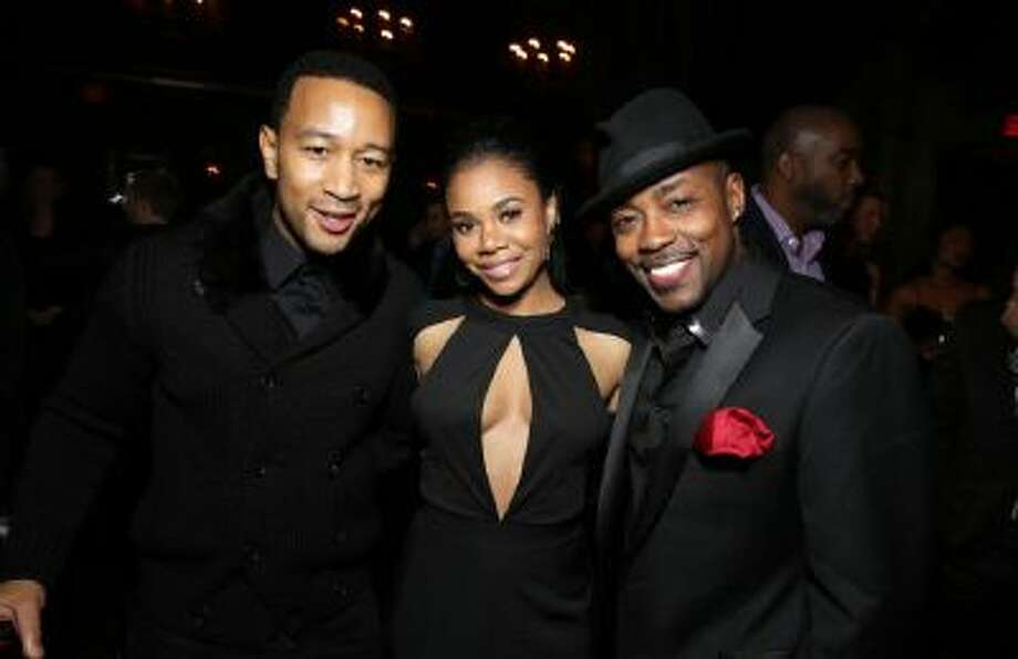"""John Legend, Regina Hall and Producer Will Packer seen at The Pan African Film & Arts Festival Premiere of Screen Gems' """"About Last Night,"""" on Feb, 11, 2014 in Los Angeles."""