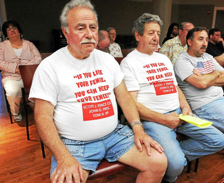 Hamden residents turn out to voice more frustration over a fence between Hamden and New Haven that was recently torn down. Tony Marone, left, and Mike Colaiacovo, Sr. wear t-shirts expressing their feelings.  mlavitt@newhavenregister.com Photo: (Mara Lavitt - New Haven Register)    / Mara Lavitt