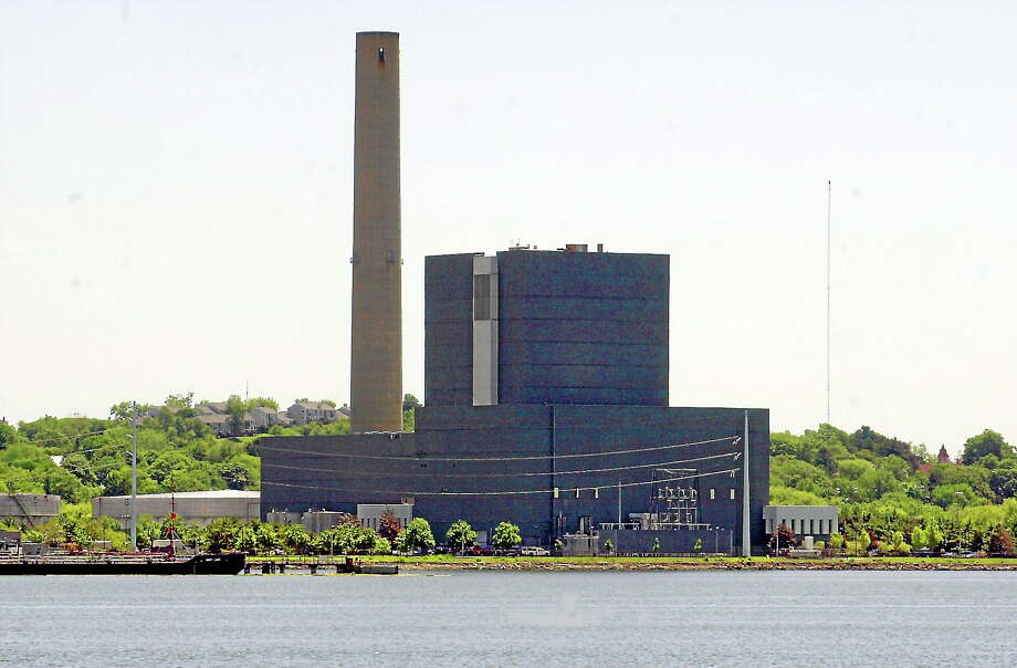This electric generating plant on the shore of New Haven Harbor owned by PSEG Power of Newark, N.J. Photo: AP Photo/Bob Child   / AP2002
