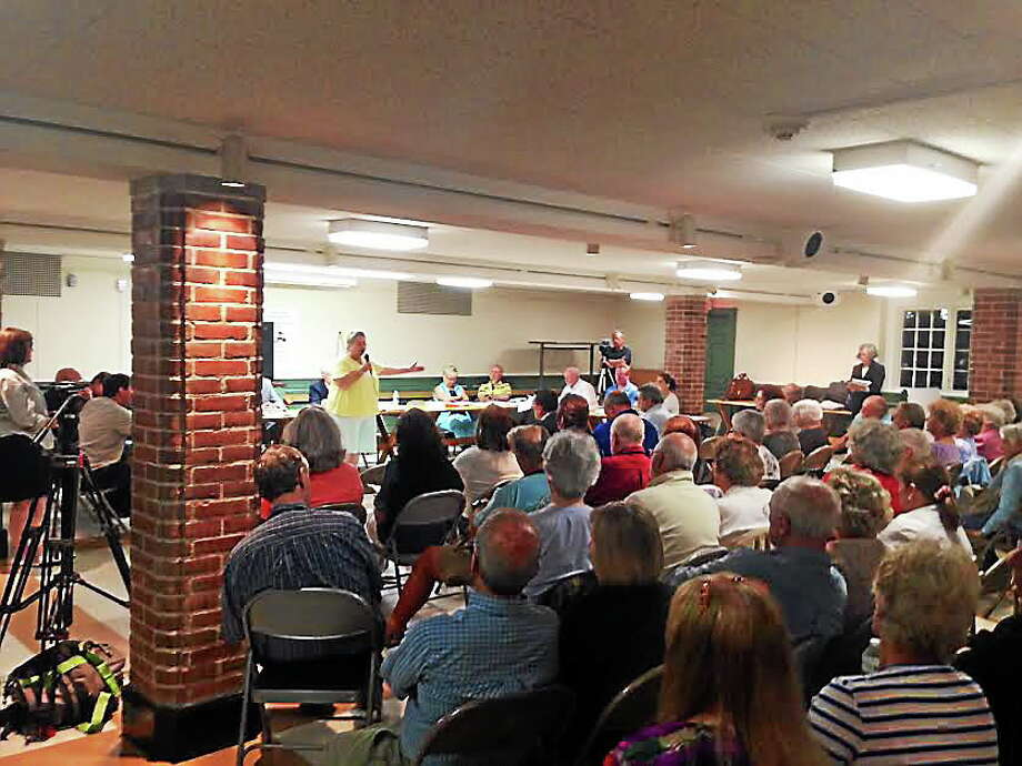 Over 100 people showed up for Monday night's meeting at Andrews Memorial Town Hall. Sean Carlin/New Haven Register Photo: Journal Register Co.