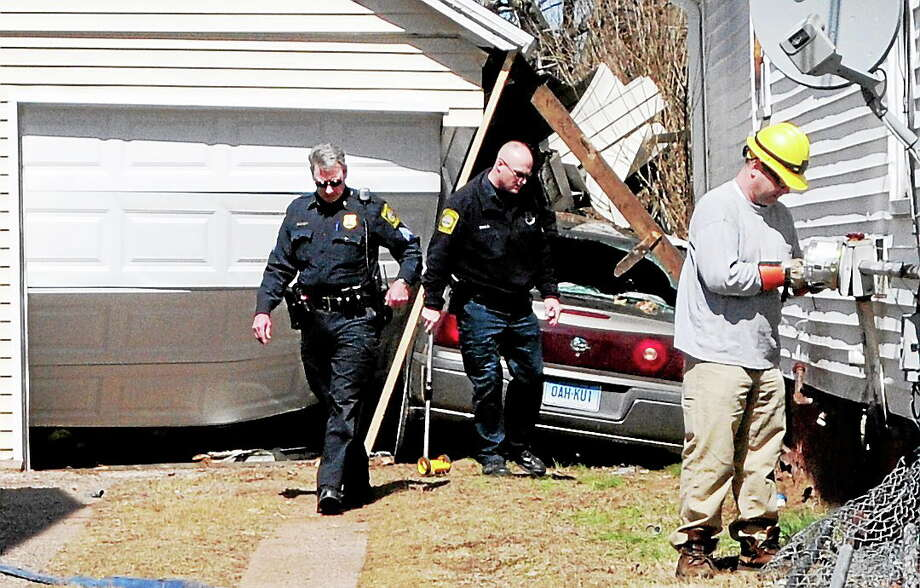 Hamden police respond to the scene of car crash Thursday afternoon on Morse Street in Hamden. Photo: Peter Hvizdak — New Haven Register   / ©Peter Hvizdak /  New Haven Register