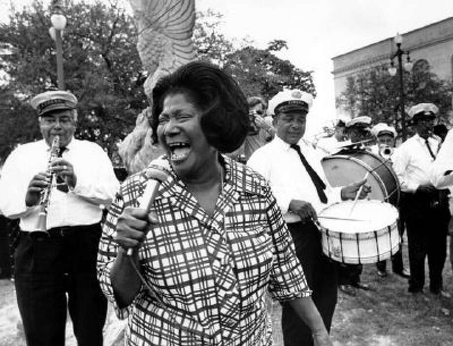 """Mahalia Jackson sings an impromptu """"Just a Closer Walk with Thee"""" to the beat of the Eureka Brass Band at the New Orleans Jazz Festival on April 23, 1970."""