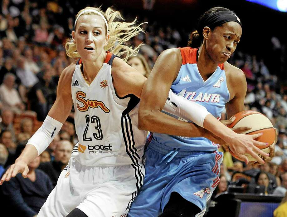Connecticut's Katie Douglas, left, tangles with Atlanta's Swin Cash, right, during Sunday's game. Photo: Jessica Hill — The Associated Press   / FR125654 AP