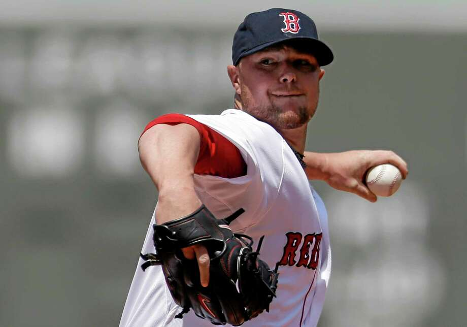 The Red Sox's Jon Lester winds up for a pitch against the Tampa Bay Rays on Sunday. The Red Sox 4-0. Photo: Steven Senne — The Associated Press   / AP