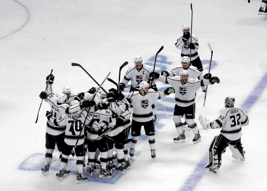 Los Angeles Kings celebrate after defeating Chicago Blackhawks 5-2 in the overtime period in Game 7 of the Western Conference finals. Photo: Charles Rex Arbogast — The Associated Press   / AP