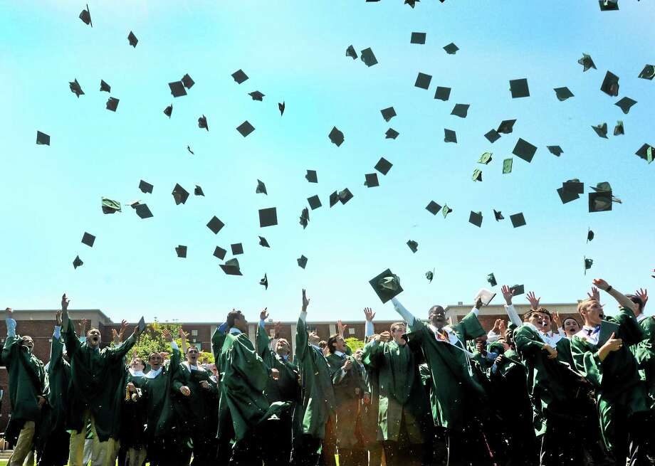 125 Notre Dame High School seniors  through their caps in the air celebrating their graduation Sunda during the 65th annual commencement exercises at the high school in West Haven. Photo: (Peter Hvizdak - New Haven Register)   / ©Peter Hvizdak /  New Haven Register