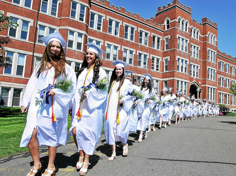 (Peter Casolino-New Haven Register)   Graduates proceed across campus during Lauralton Hallís 108th Commencement Ceremony in Milford, CT. pcasolino@newhavenregister.com Photo: Journal Register Co.