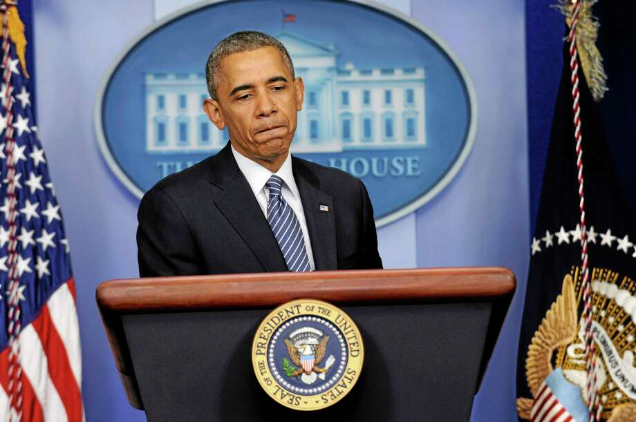 President Barack Obama pauses while making a statement in the Brady Press Briefing Room of the White House in Washington, Friday, May 30, 2014, following his meeting with Veterans Affairs Secretary Shinseki. The president said that Shinseki is resigning amid widespread troubles with veterans' health care.(AP Photo/Susan Walsh) Photo: AP / AP