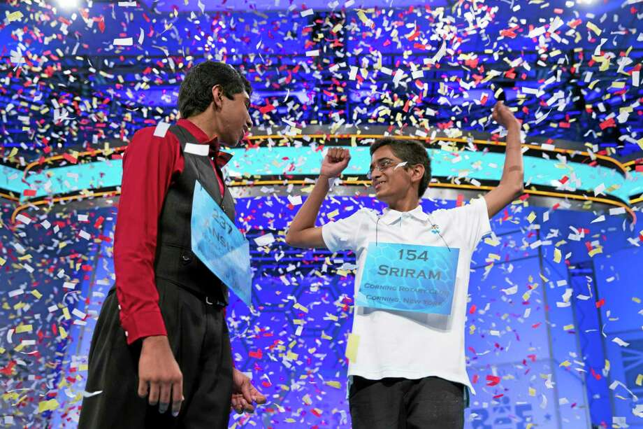 Ansun Sujoe, 13, of Fort Worth, Texas, left, and Sriram Hathwar, 14, of Painted Post, N.Y., celebrate after being named co-champions of the National Spelling Bee, on Thursday, May 29, 2014, in Oxon Hill, Md. (AP Photo/Evan Vucci) Photo: AP / AP