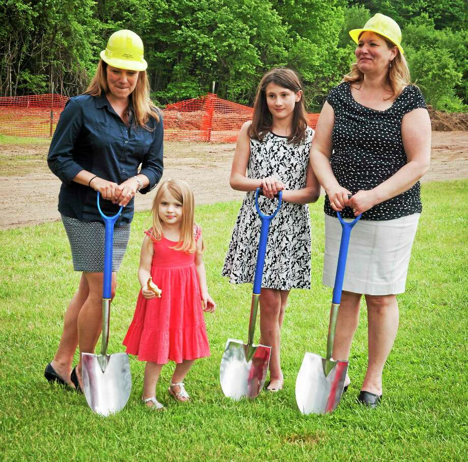 Left to right: Teri Schatz, Gabriella Inclima, Kate Inclima, and Colleen Inclima at the groudbreaking for a playground for children with special needs. Photo: (Melanie Stengel - New Haven Register)