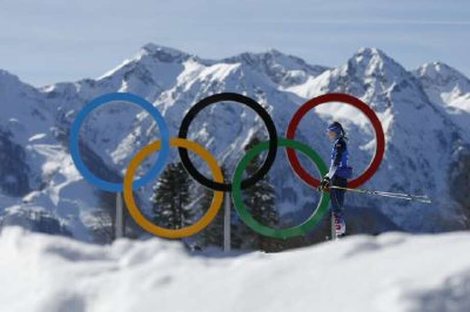 Annelies Cook of the United States passes by the Olympic rings during a biathlon training session prior to the 2014 Winter Olympics, Friday, Feb. 7, 2014, in Krasnaya Polyana, Russia.