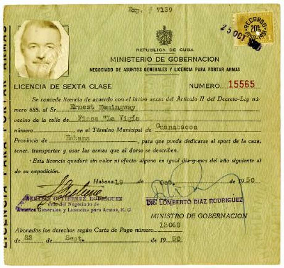 This photo released Feb. 11 by the John F. Kennedy Presidential Library and Museum in Boston, shows Ernest Hemingway?s 1950 license to carry arms in Cuba.