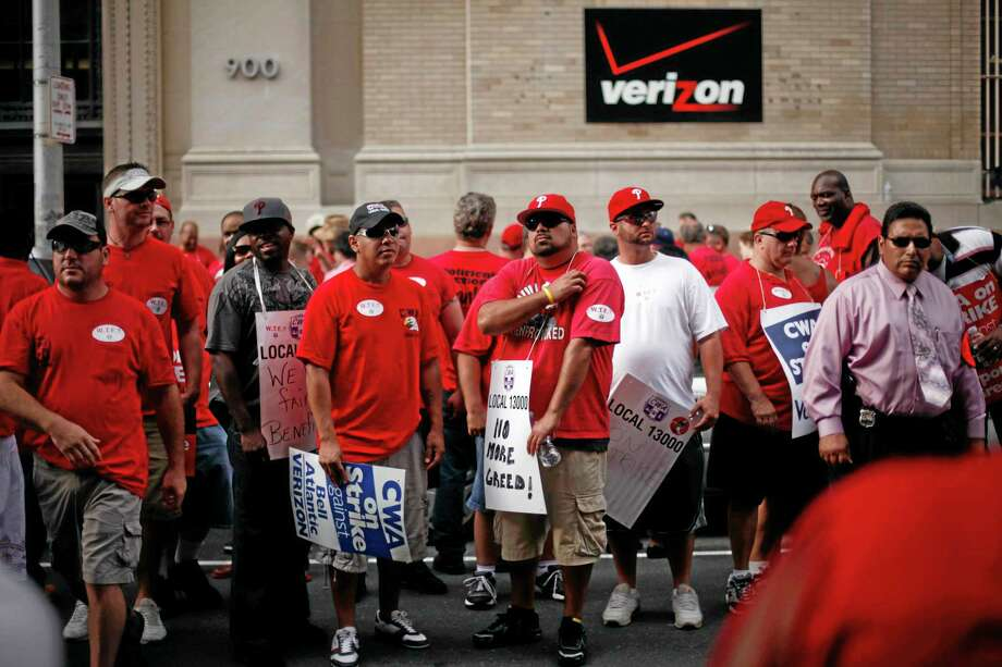 In this Aug. 8, 2011, photo, Verizon workers picket outside one of the company's central offices, in Philadelphia. Photo: Matt Rourke — The Associated Press   / AP