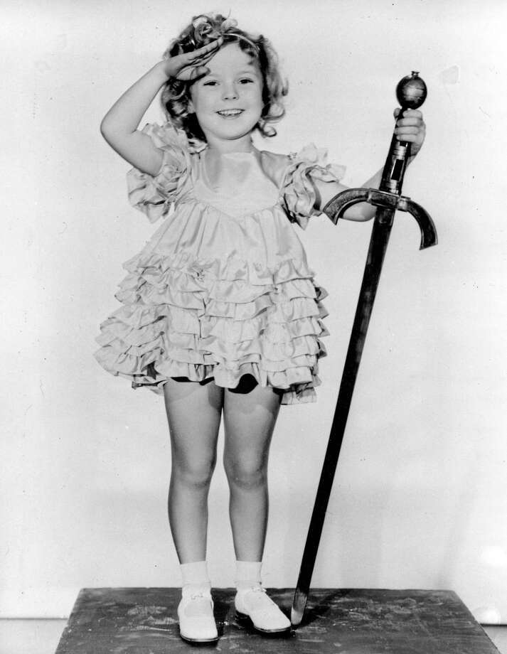 """FILE - In this 1933 file photo, child actress Shirley Temple is seen in her role as """"Little Miss Marker."""" Shirley Temple, the curly-haired child star who put smiles on the faces of Depression-era moviegoers, has died. She was 85. Publicist Cheryl Kagan says Temple, known in private life as Shirley Temple Black, died Monday night, Feb. 10, 2014, surrounded by family at her home near San Francisco. (AP Photo/File) Photo: AP / AP"""