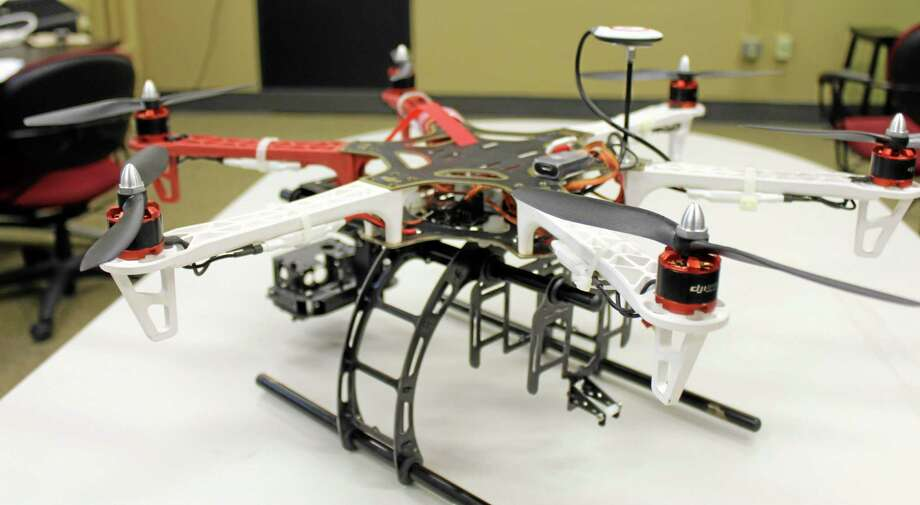 In this March 2012 photo provided by The University of Missouri, in Columbia, Mo., is a DJI 550 drone with an attached camera mount that the university says is probably the model it will file for permission to use. The FAA is developing new rules as the technology makes drones far more versatile, but for now operators can run afoul of regulations by using them for commercial purposes, including journalism. (AP Photo/University of Missouri, Zach Garcia, File) Photo: AP / The University of Missouri