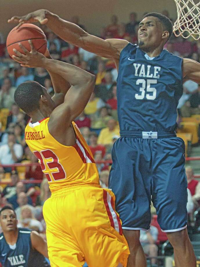 Virginia Military Institute's Tim Marshall has his shot blocked by Yale's Brendon Sherrod (35) during the second half of Tuesday's  CIT semifinal. Yale won  75-62. Photo: Don Petersen — The Associated Press   / Roanoke Times