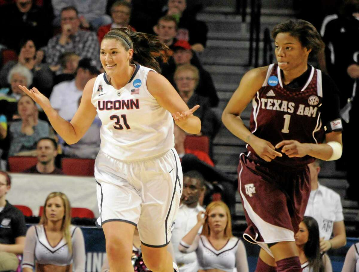 UConn's Stefanie Dolson is all smiles during the Huskies' Elite Eight win over Courtney Williams and Texas A&M on Monday in Lincoln, Neb.