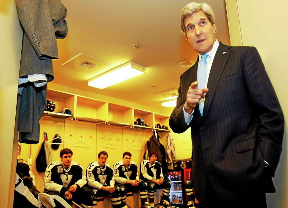 "U.S. Secretary of State John Kerry gives a pep talk to members of the Yale University hockey team before they take on Harvard University at the ""Rivalry on Ice"" game, Jan. 11, 2014, in New York. Photo: Adam Hunger — Leverage Agency — The Associated Press   / AP Images"