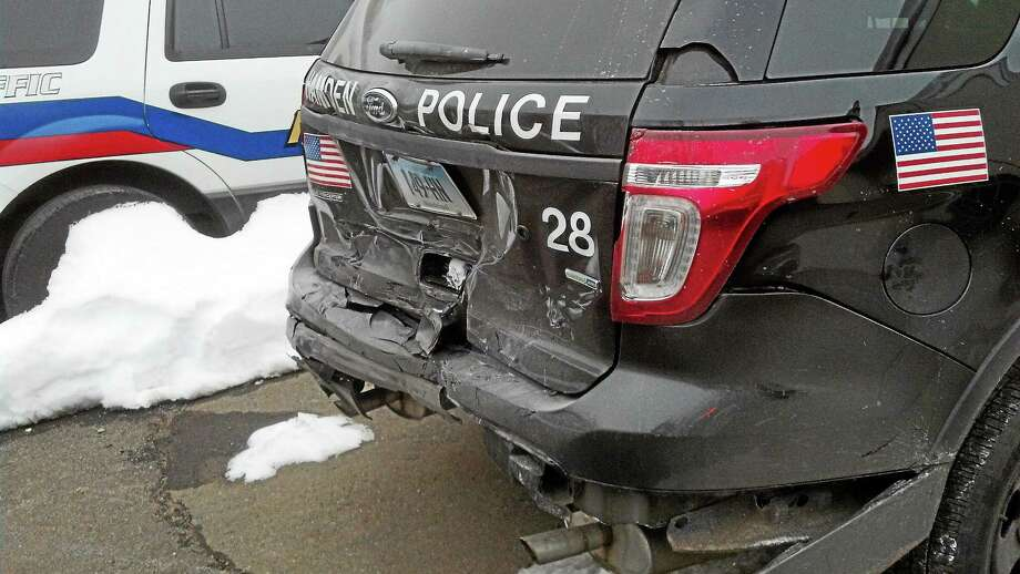 A Hamden police vehicle was damaged after it was struck by a woman who was accused of driving under the influence Sunday. Photo: Submitted Photo — Hamden PolicE