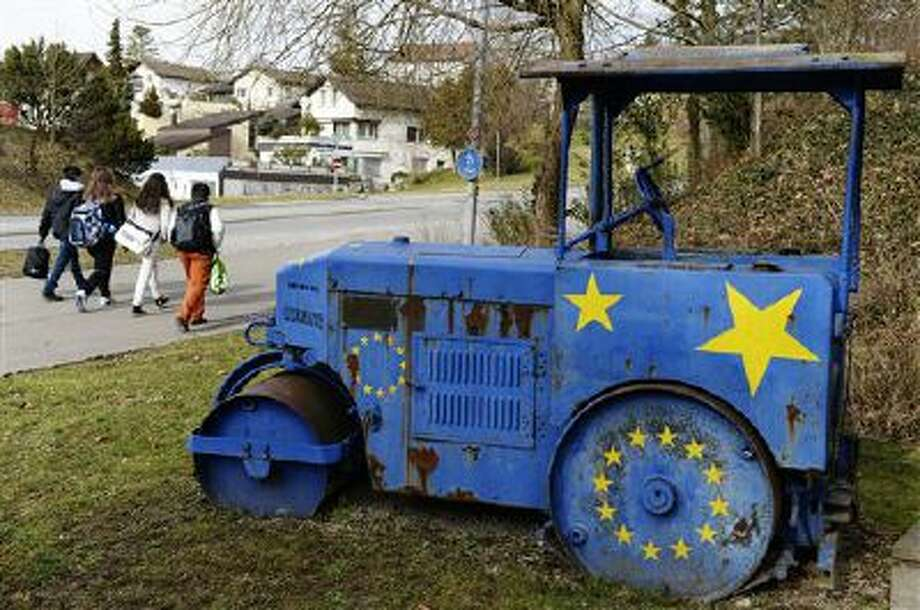 "An old steam roller painted with the EU stars sits Monday in Kloten, Switzerland. The choice by Swiss voters to impose curbs on immigration is sending shock waves throughout the European Union, with EU leaders on Monday warning the Swiss had violated the ""sacred principle"" of Europeans' freedom of movement and politicians anxiously trying to gauge the vote's impact on burgeoning anti-foreigner movements in other countries. Photo: AP / KEYSTONE"