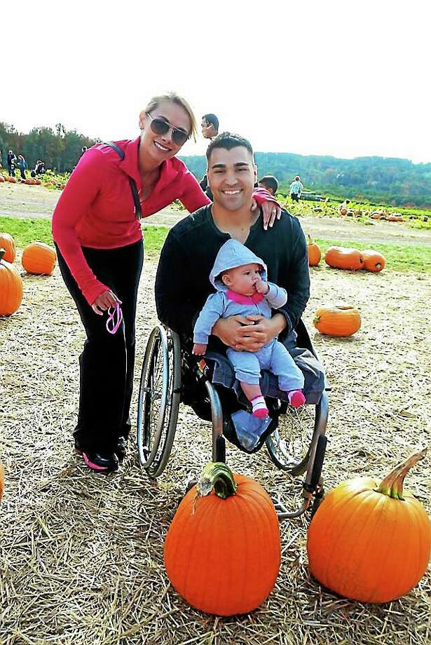 JohnTartaglio, his wife, Genevieve, and their daughter, Lillian. Photo: Journal Register Co.