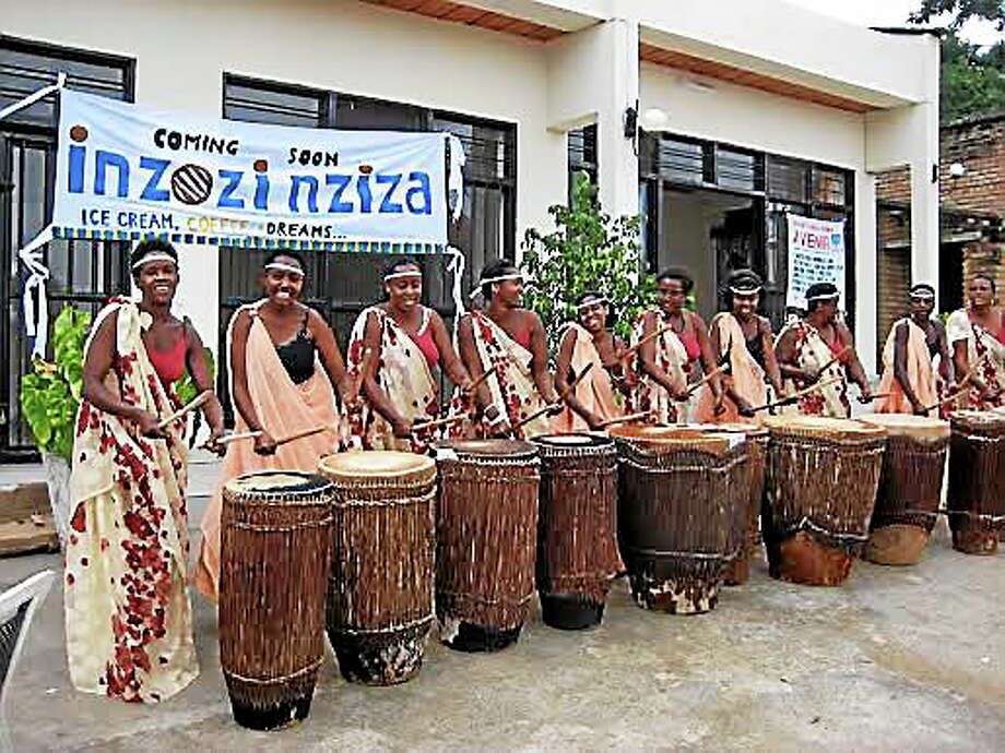 A women's drumming troupe plays in front of Sweet Dreams, an ice cream shop in the city of Butare in Rwanda. Photo: CONTRIBUTED PHOTO