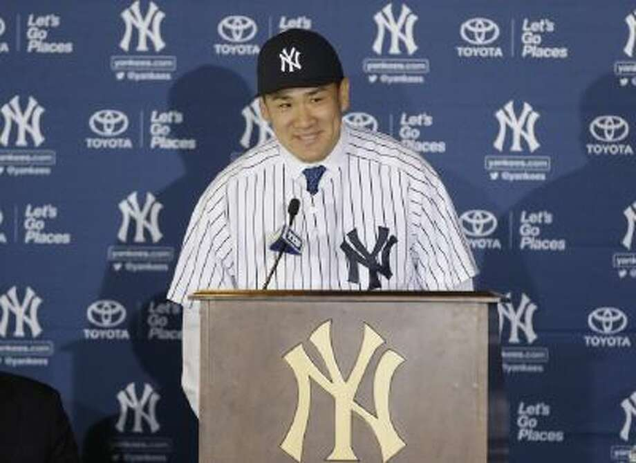 New York Yankees pitcher Masahiro Tanaka, of Japan, speaks during a news conference at Yankee Stadium Tuesday in New York.