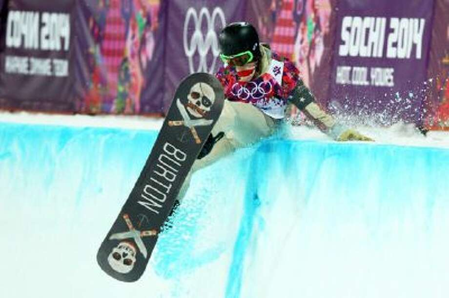 American Shawn White crashes out during his first run in the Snowboard Men's Halfpipe Finals on day four of the Sochi 2014 Winter Olympics at Rosa Khutor Extreme Park on Feb. 11 in Sochi, Russia.