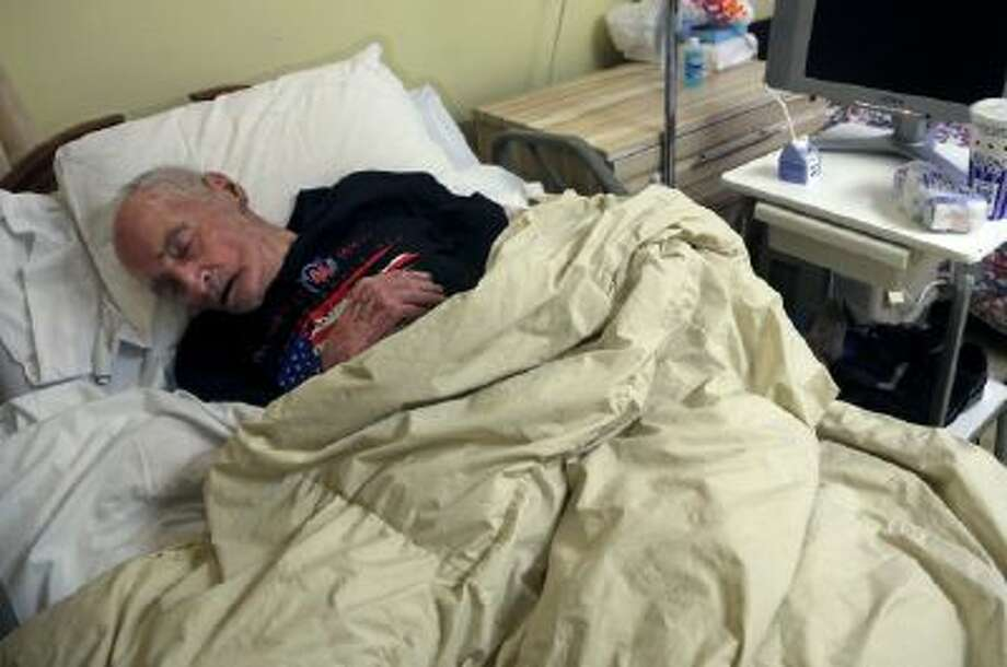 Morris Markowitz sleeps in his room at the Crown Nursing and Rehabilitation Center in the Brooklyn borough of New York.
