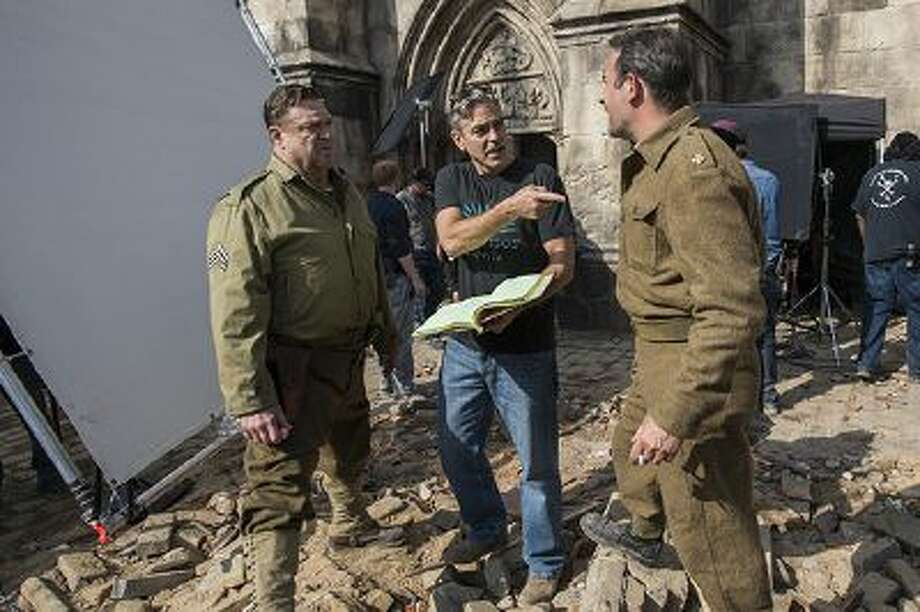 "This image released by Columbia Pictures shows John Goodman, left, actor-director George Clooney and Jean Dujardin, right, on the set of ""The Monuments Men."" Photo: AP / Columbia Pictures - Sony"